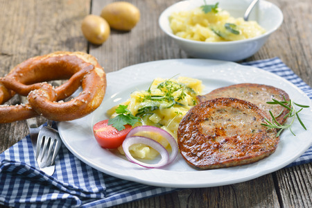 whimsy: Bavarian food: Fried slices of sausage with pieces of pig spleen (so called Milzwurst) served with potato salad