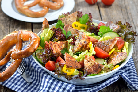 whimsy: Bavarian salad: Pieces of fried sausage with pig spleen served on a colorful mixed salad
