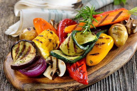 Vegan cuisine: Grilled mixed vegetables on a wooden cutting board