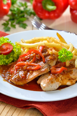downloaded: Hot escalope of turkey with red pepper sauce and French fries