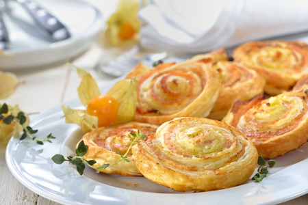 Baked hearty puff pastry rolls with smoked slamon, cream cheese and fesh herbs Reklamní fotografie