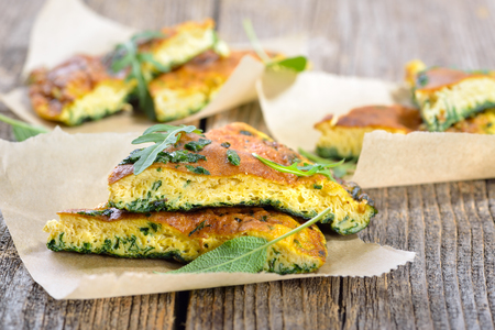 Cuts of delicious herb omelette with parmesan cheese