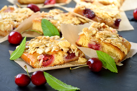 Yeast cake with fresh cherries and crunchy almond caramel Reklamní fotografie