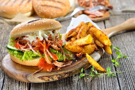 Pulled pork sandwich with potato wedges