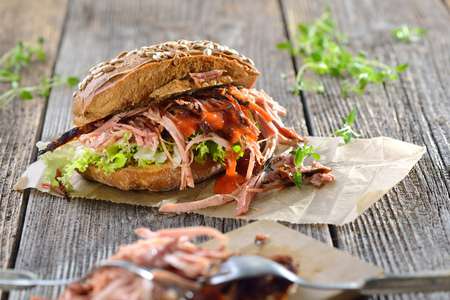 Pulled pork sandwich on a wooden table Reklamní fotografie