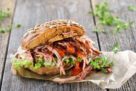 Steet food: Pulled pork sandwich on a wooden table