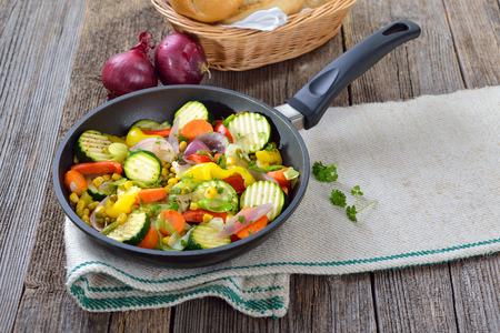 A vegan meal: Mixed short fried vegetables served in a pan