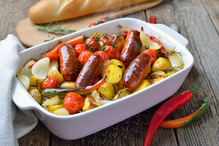 Mediterranean food: Baked Spanish chorizo sausages with rosemary baby potatoes and other vegetables
