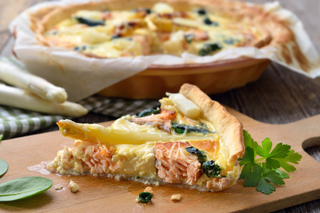 Baked quiche with fresh asparagus, smoked salmon and spinach