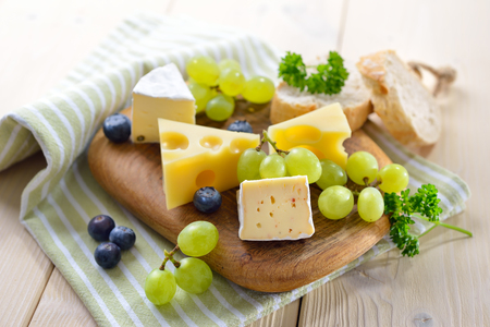 Cheese snack on a wooden cutting board