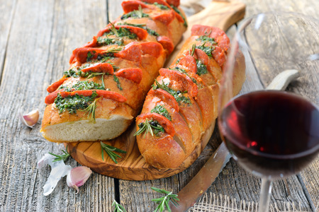 Chorizo salami on roasted bread served with a glass of tempranillo red wine