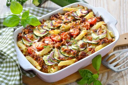 Zucchini pasta casserole with mince and cheese served hot from the oven