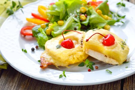 Sweet baked chicken escalope with pineapple slices and melted cheese Banco de Imagens
