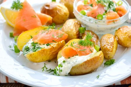 Jacket potatoes fresh from the oven served with herb curd and smoked salmon