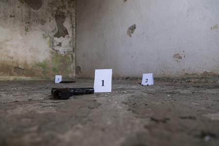 telltale: pistol, criminal, crime, offense, transgression, pistol, bulet, bulets, wrongdoing, clues, clue, sleeves Stock Photo