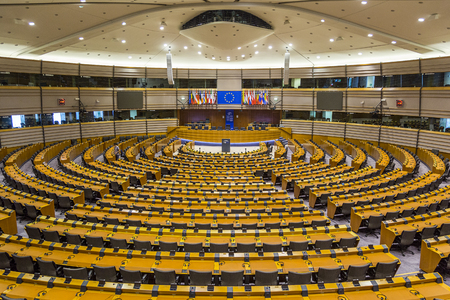 European Parliament in Brussels  Belgium  06.27.2018 from inside emptied. a large empty hall in a massive administrative building and the flags of the EU Member States.