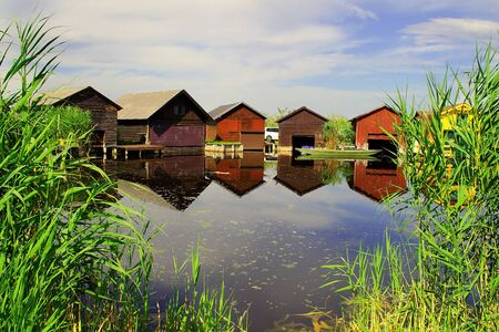 Picturesque fishing huts on the shore of Lake Neusiedl, Austria. Stock fotó