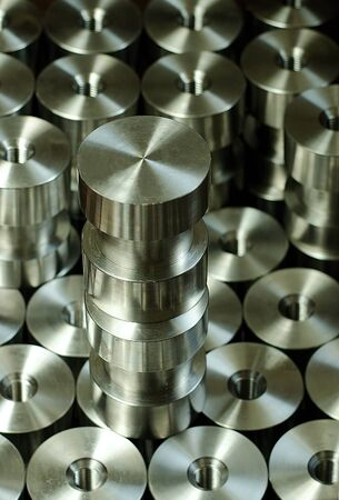 Series of round pieces with thread made with lathe tourning. Product of CNC machining. Stainless steel. CNC machining concept. 版權商用圖片