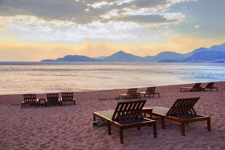 Chairs on sandy beach resort in cape St.Stefan, Montenegro. 写真素材