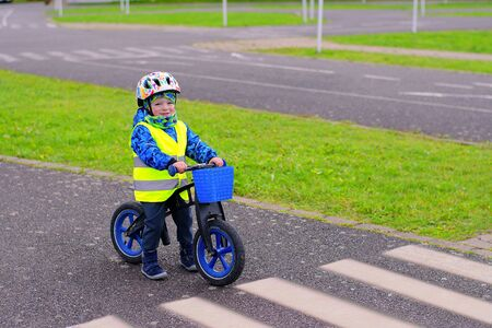 Little child training on traffic playground on pushbike Stock Photo
