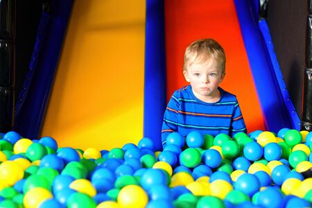 Lonely toddler in playing centre Stock Photo