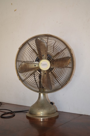 antique table: Antique table fan for about 80 years.
