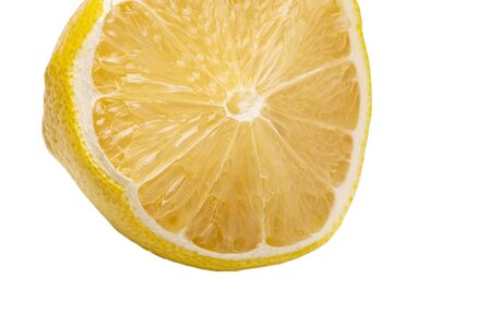 on a white background, the part of the lemon is not cut evenly