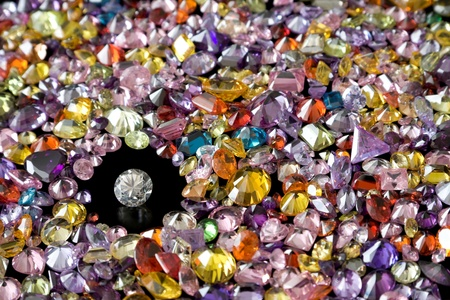 large group of objects: Solitaire Diamond Surrounded By Colorful Gems
