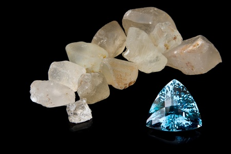 Trilliant Cut Blue Topaz And Rough Stones Stock Photo - 12433232