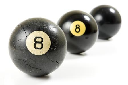 bola ocho: ¿Cuál es realmente detrás de la bola ocho Foto de archivo