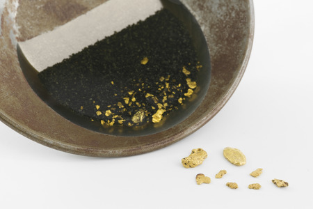 placer: A gold pan with natural placer gold Stock Photo