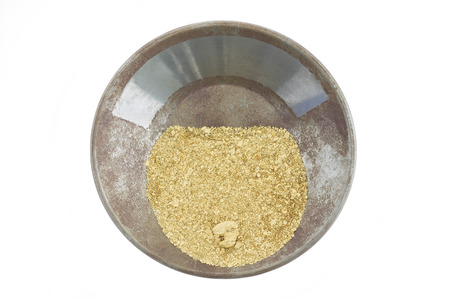 placer: A gold pan filled with natural placer gold Stock Photo