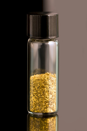 placer: Natural placer gold and nuggets in a glass vial