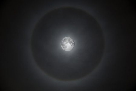 Full moon surrounded by a glowing misty halo Stok Fotoğraf