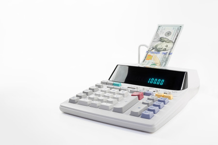 Financial calculator with a glowing digital display, dispensing money