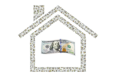 Hundreds of bills creating an outline depicting home finance Stock Photo