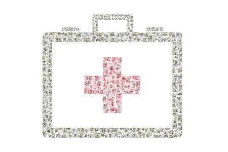 medical bills: Hundreds of bills depicting a medical kit Stock Photo
