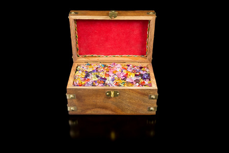 Treasure chest full of colorful precious gems