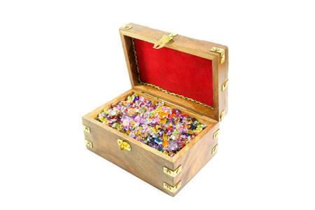 Treasure chest full of colorful precious gems photo