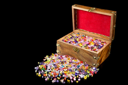 Treasure chest overflowing with colorful precious gems