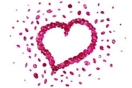 rubies: Heart shape formed by a collection of precious red rubies Stock Photo