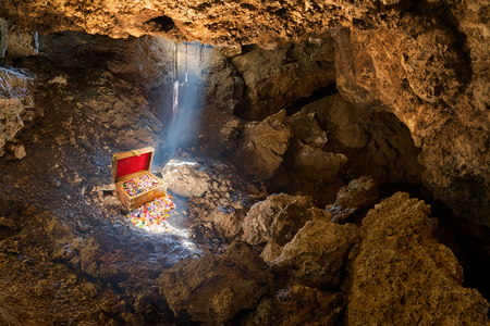 Cave with skylight streaming sunlight on a treasure chest