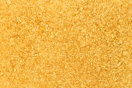 A background consisting of natural placer gold nuggets Stok Fotoğraf