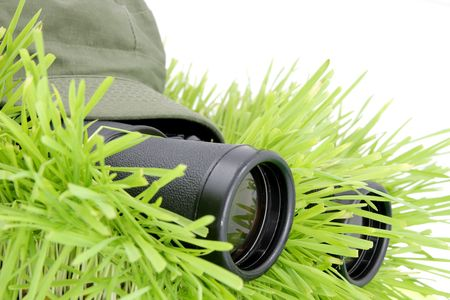 Scout. Soldier with field-glasses hidden in the grass Stock Photo