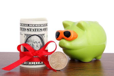 Piggy Bank. Fun green piggy- bank and dollar photo