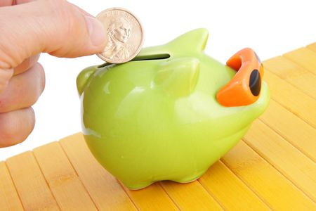 fun green piggy bank and dollar  photo