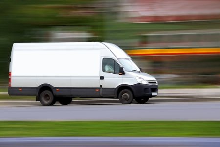 loading cargo: Blur speedy  white van with white blank for your text