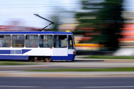 tramcar: Old blue tram rider fast on rails, Wroclaw, Poland
