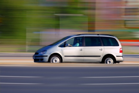 Woman driver is speeding through the city Stock Photo - 10327637