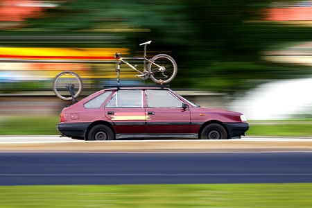 Old worn-out polish car and sports bike, just in case Stock Photo - 10327634